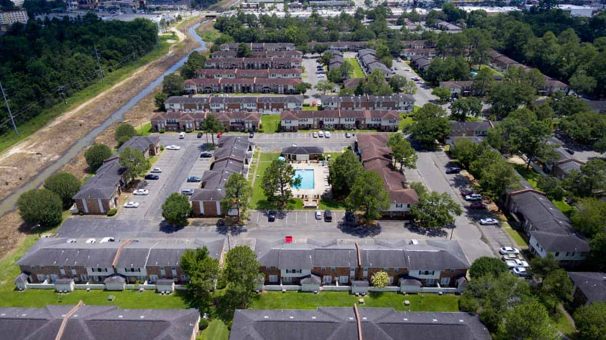 aerial drone photo of apartment complex with swimming pool in center in Mobile, AL