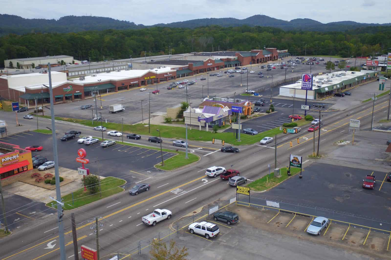drone photo of shopping plaza and storefronts