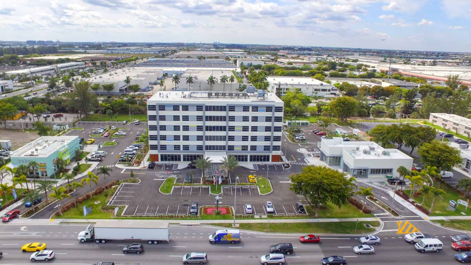Aloft Miamia hotel front view next to highway taken from a drone
