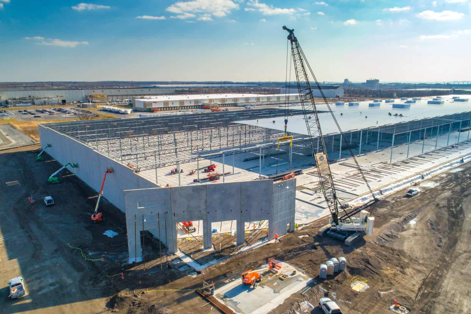 drone photo of crane installing new wall of massive commercial building in Maryland