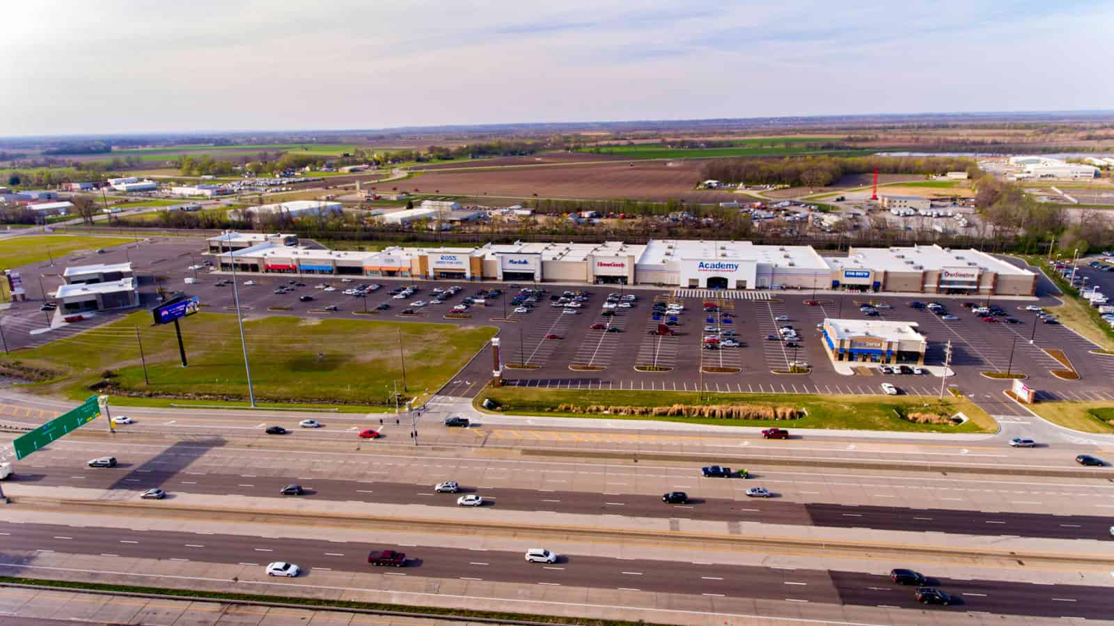 drone photo of shopping center in Missouri with Marshalls, Ross, and HomeGoods