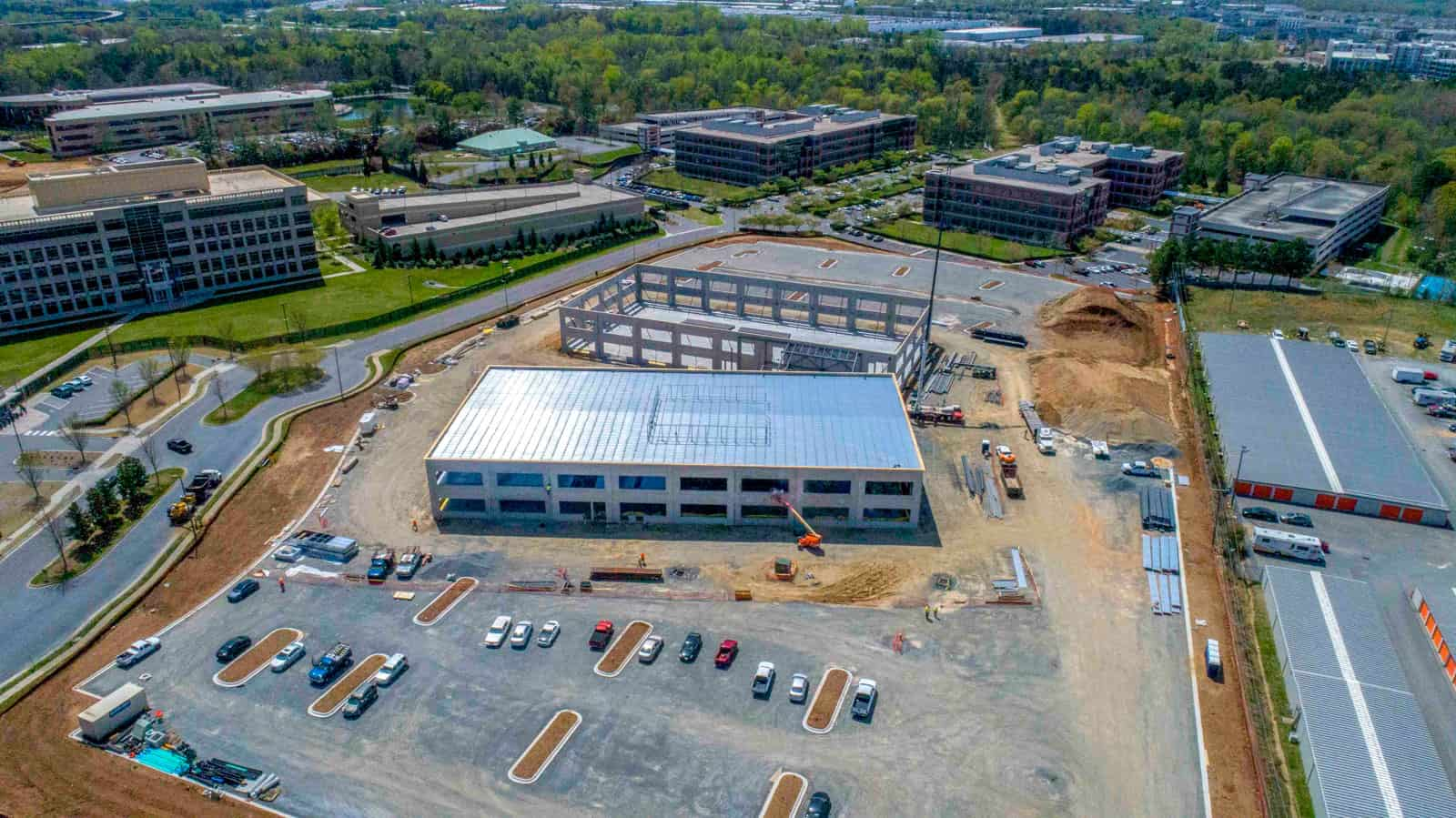 drone photo of construction site in North Carolina with completed building and frame of second buildling