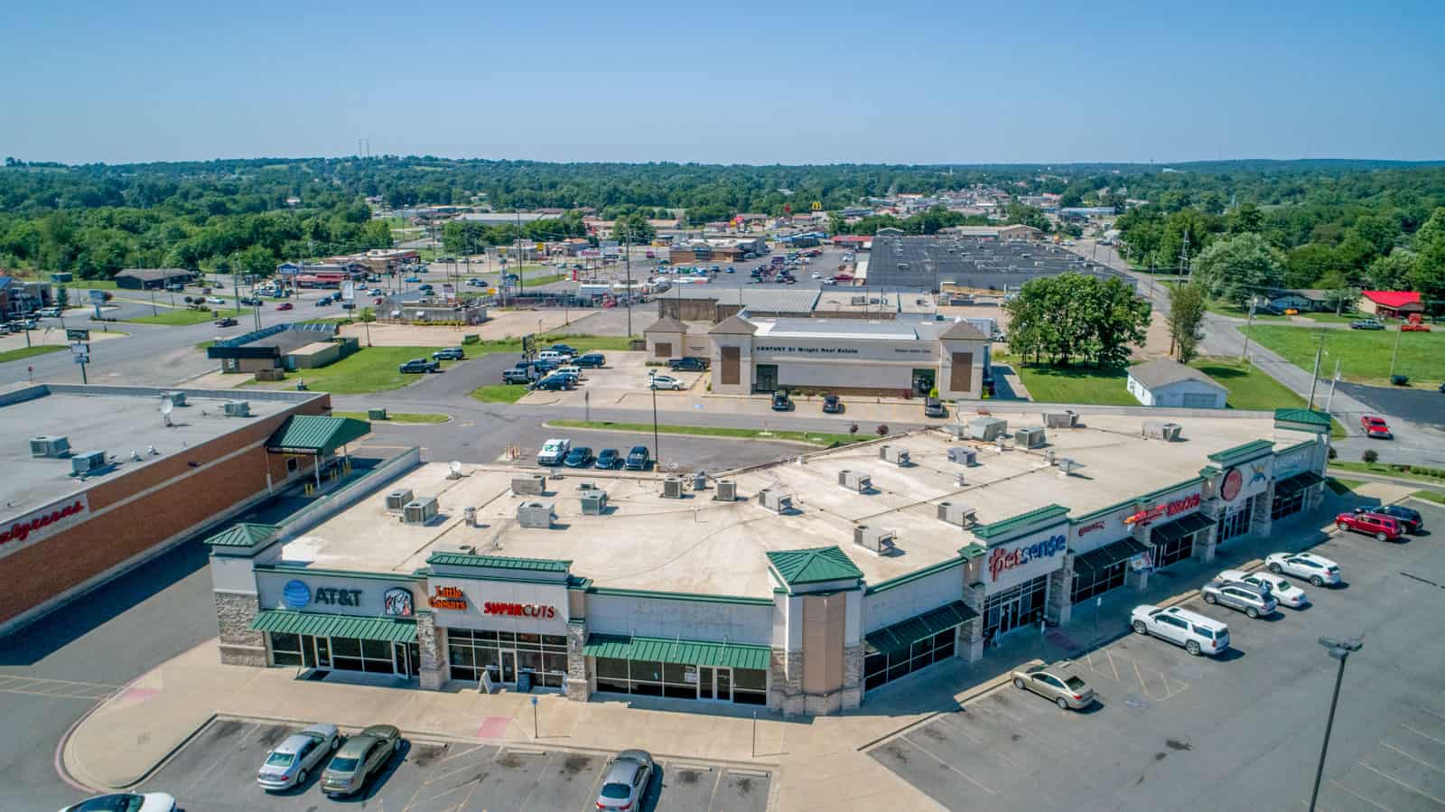 aerial drone photo of storefronts in commercial shopping center in Ohio