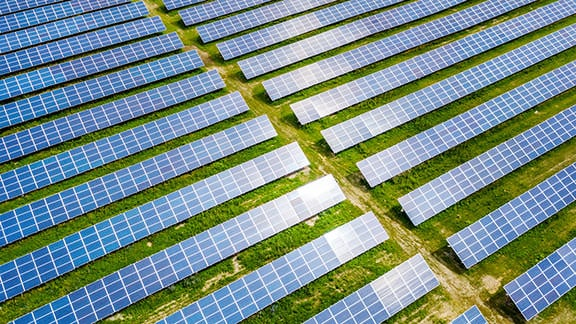 aerial drone photo looking down at solar panels in field