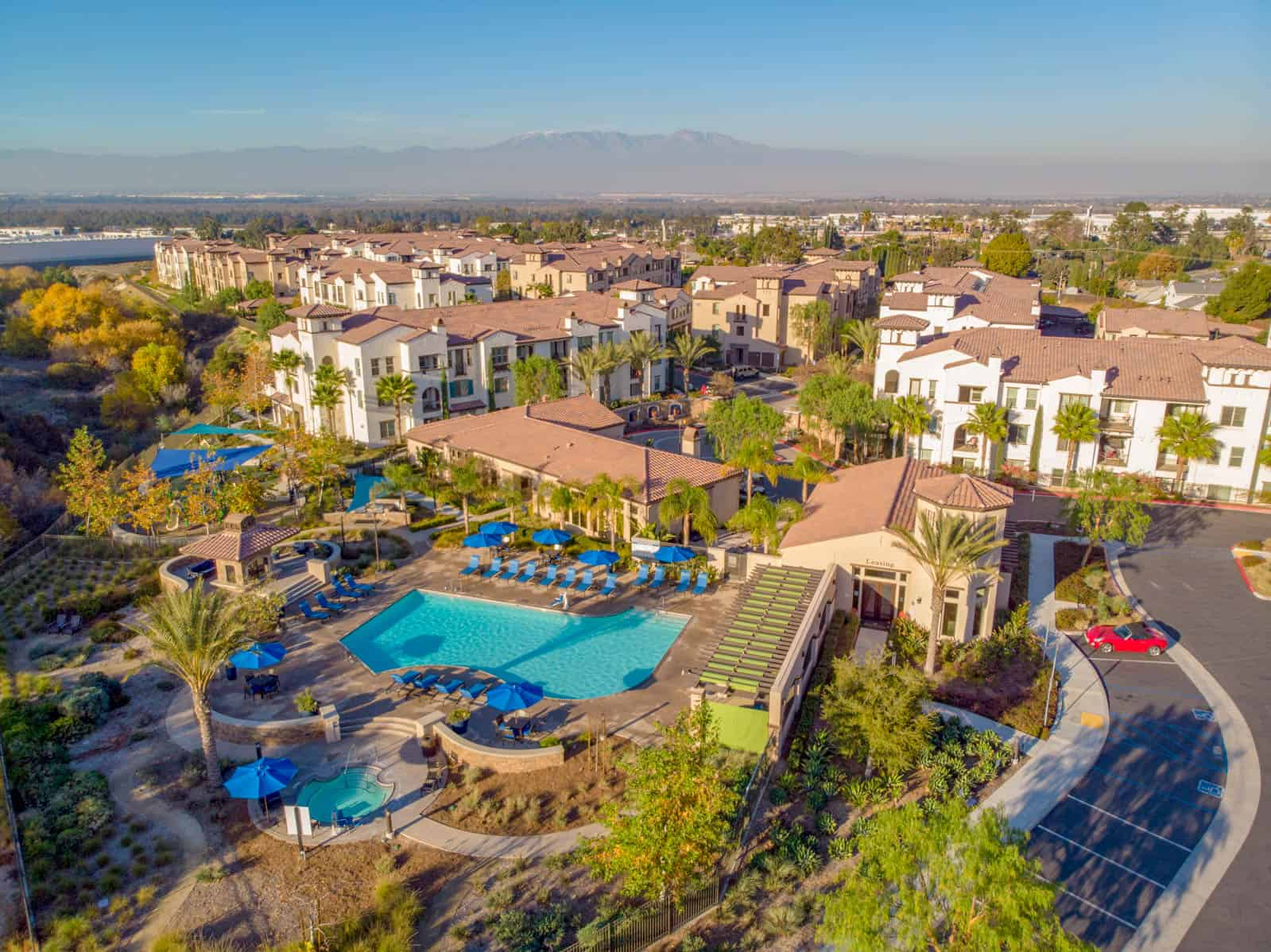 aerial drone photo of apartment community in Corona, CA with swimming pool in foreground