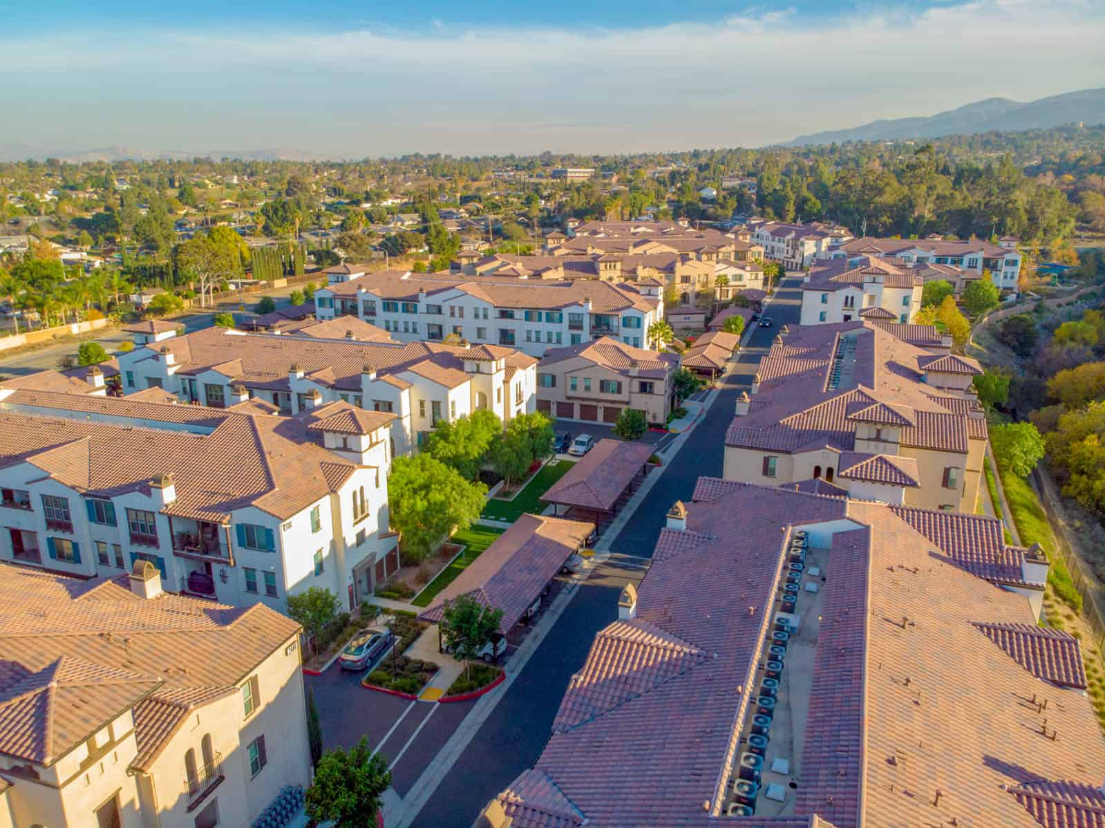 aerial drone photo of apartment building rooftops in Corona, California