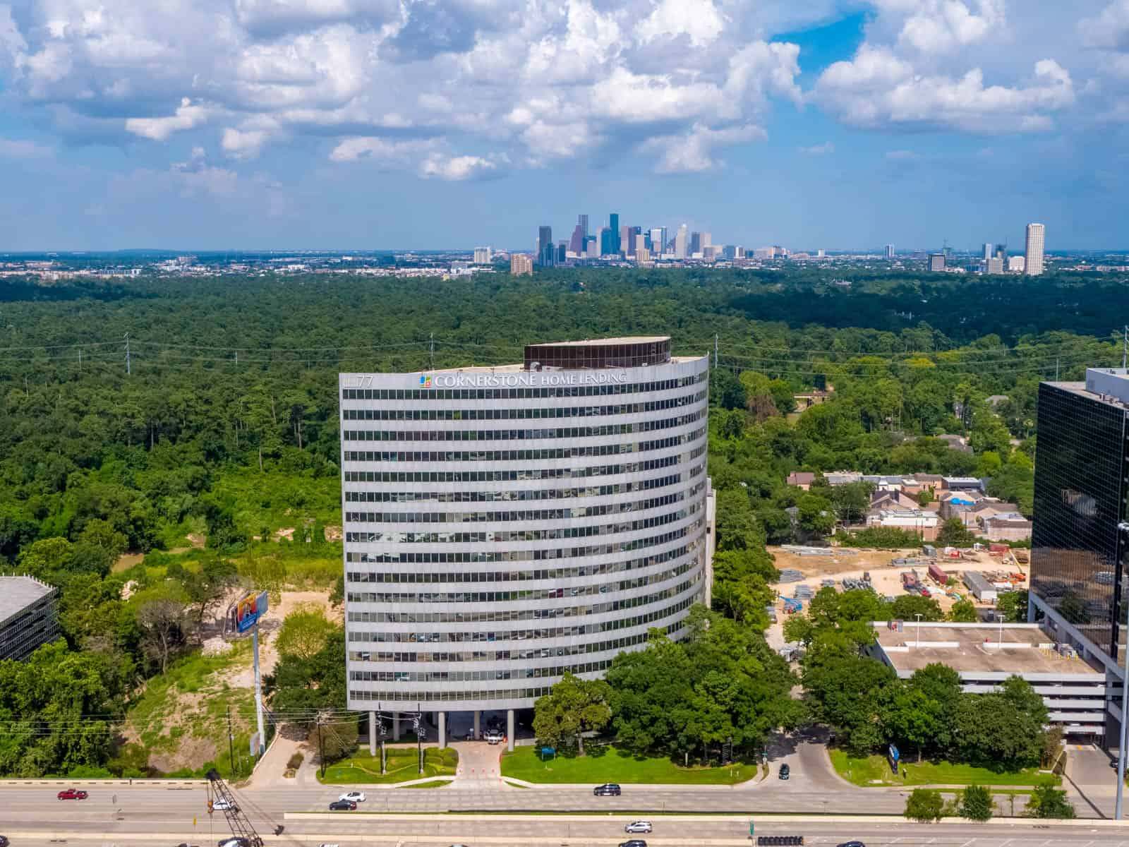 aerial drone photo of newly constructed office building in Texas with city in background