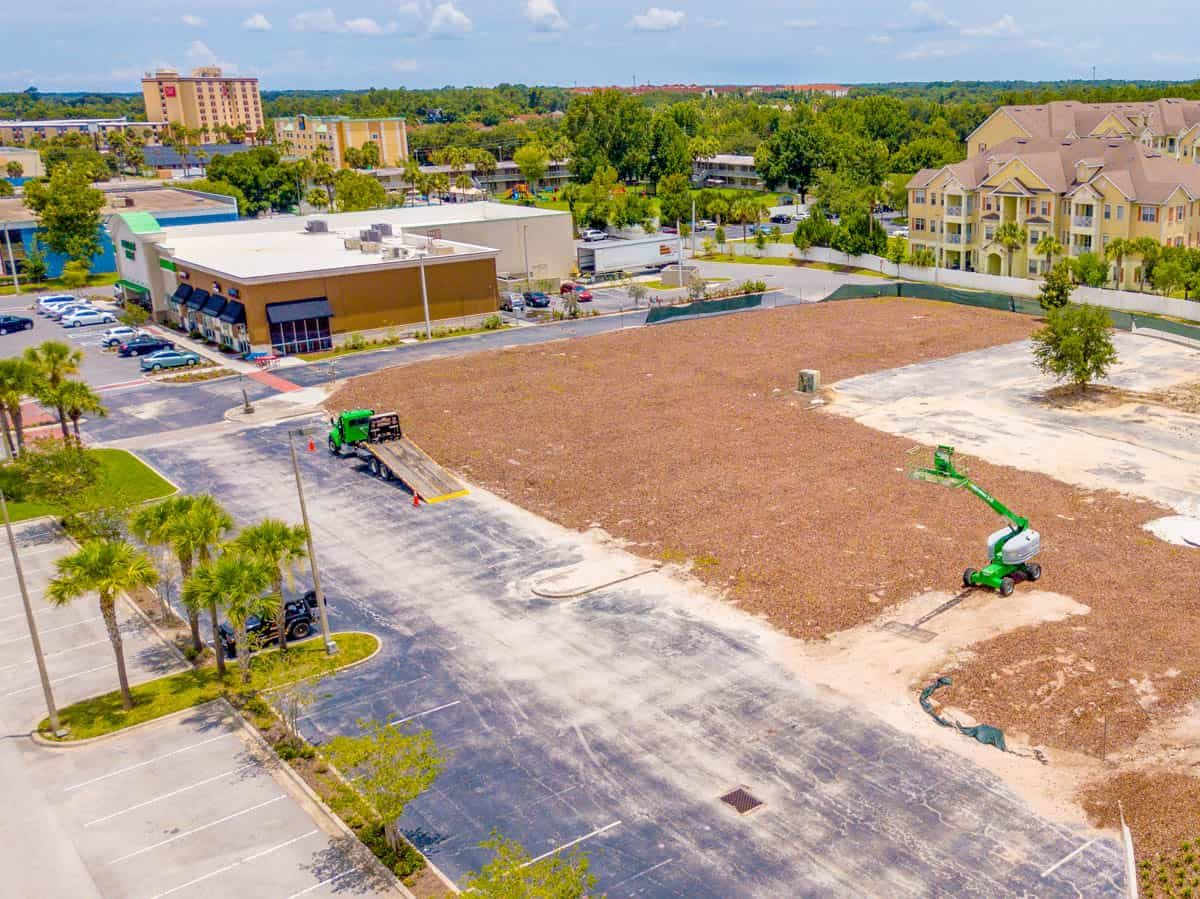 low altitude aerial drone photo of construction project between two shopping centers in Kissimmee, Florida