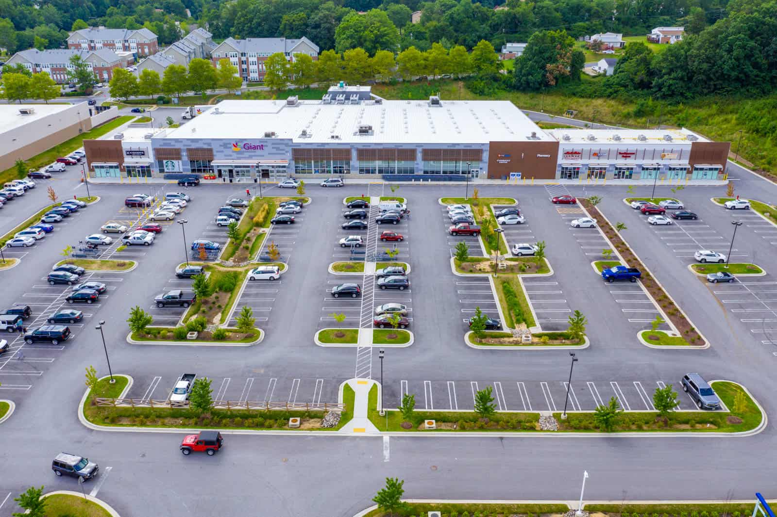 arial drone photo of shopping plaza in Baltimore, Maryland facing the storefronts
