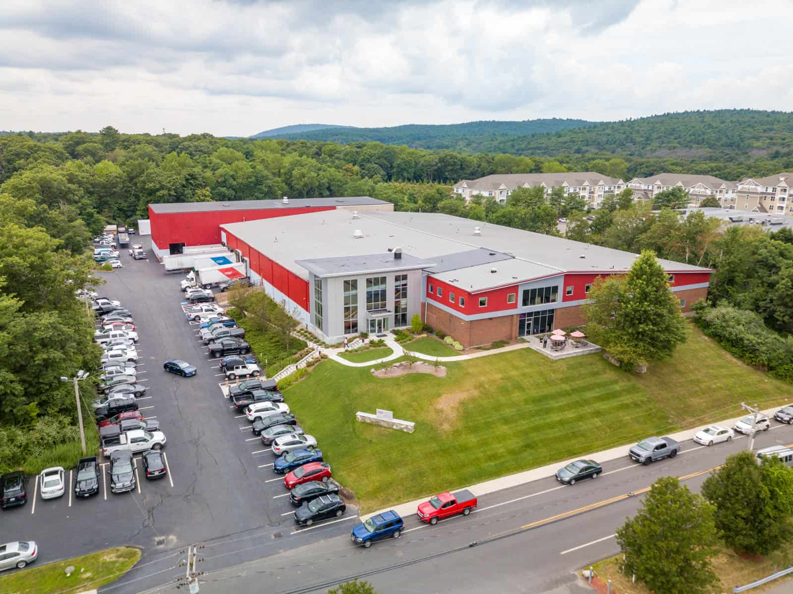 drone photo of front of red office building in Randolph, Massachusetts