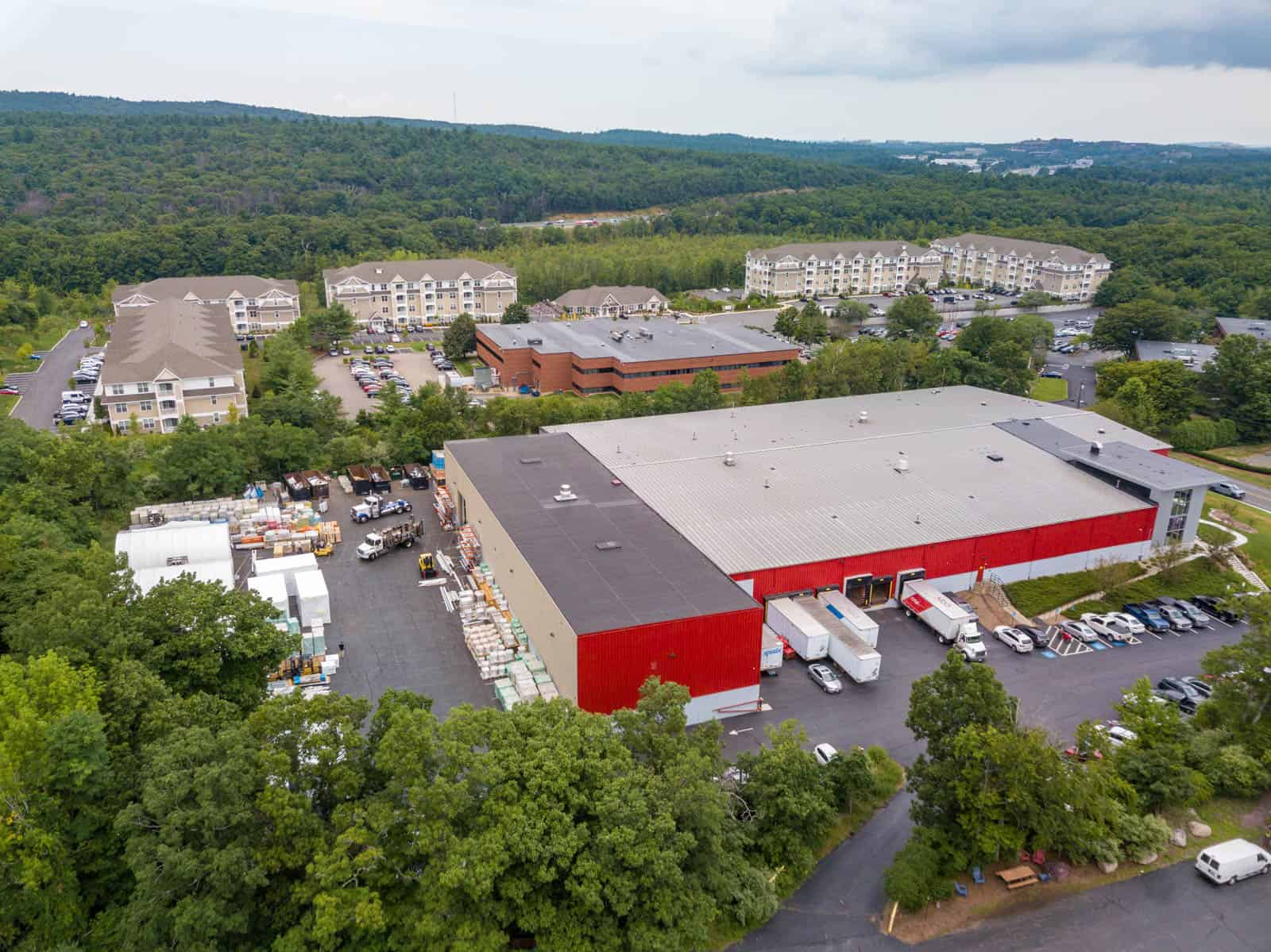 aerial drone photo of truck bays and supplied behind office building in Randolph, Massachusetts