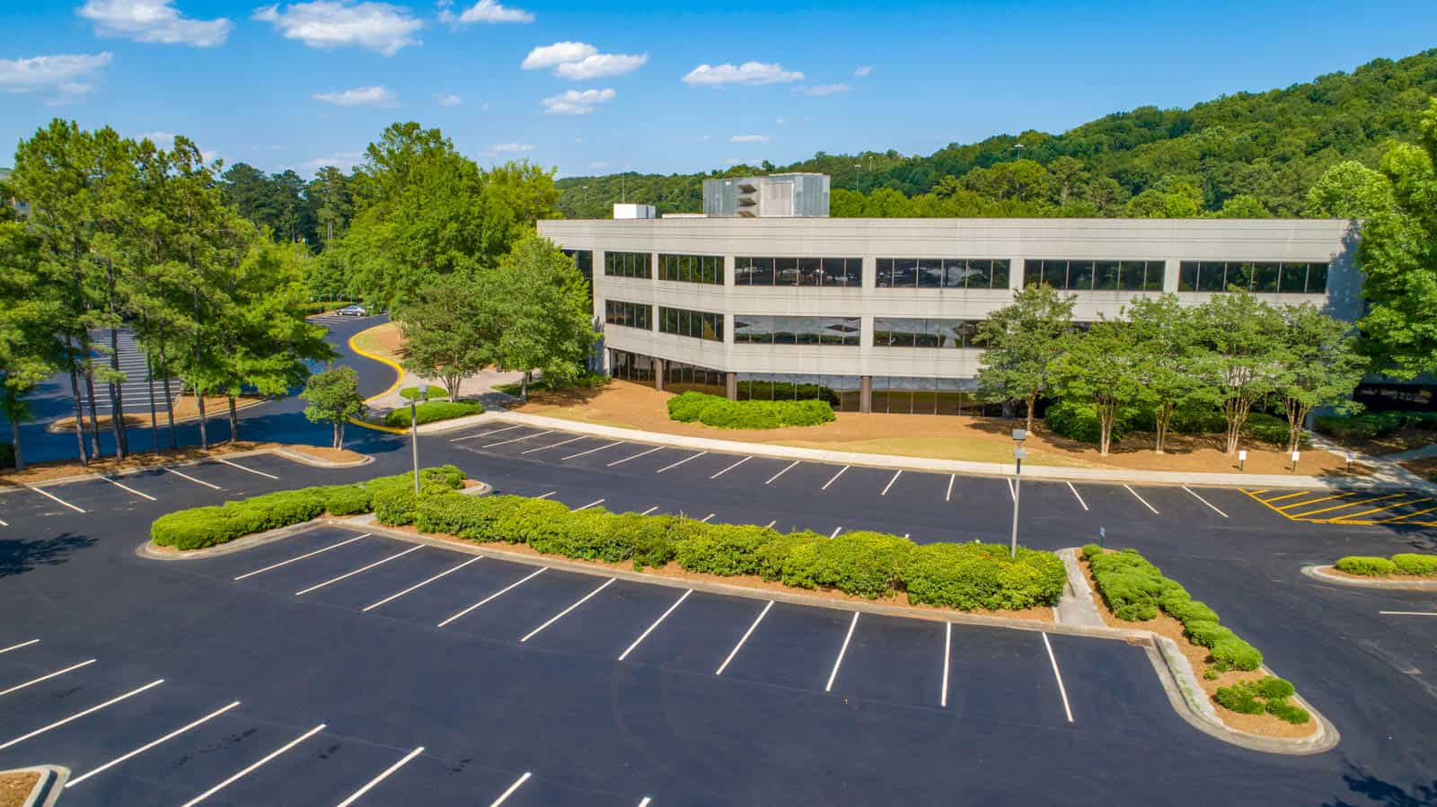 aerial drone photo of commercial real estate property in Gainesville, GA with full building and parking lot in view