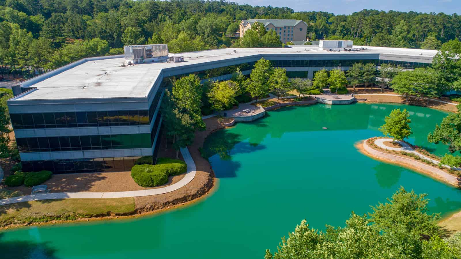 drone photo of office building with vibrant green pond video in foreground in Birmingham, Alabama