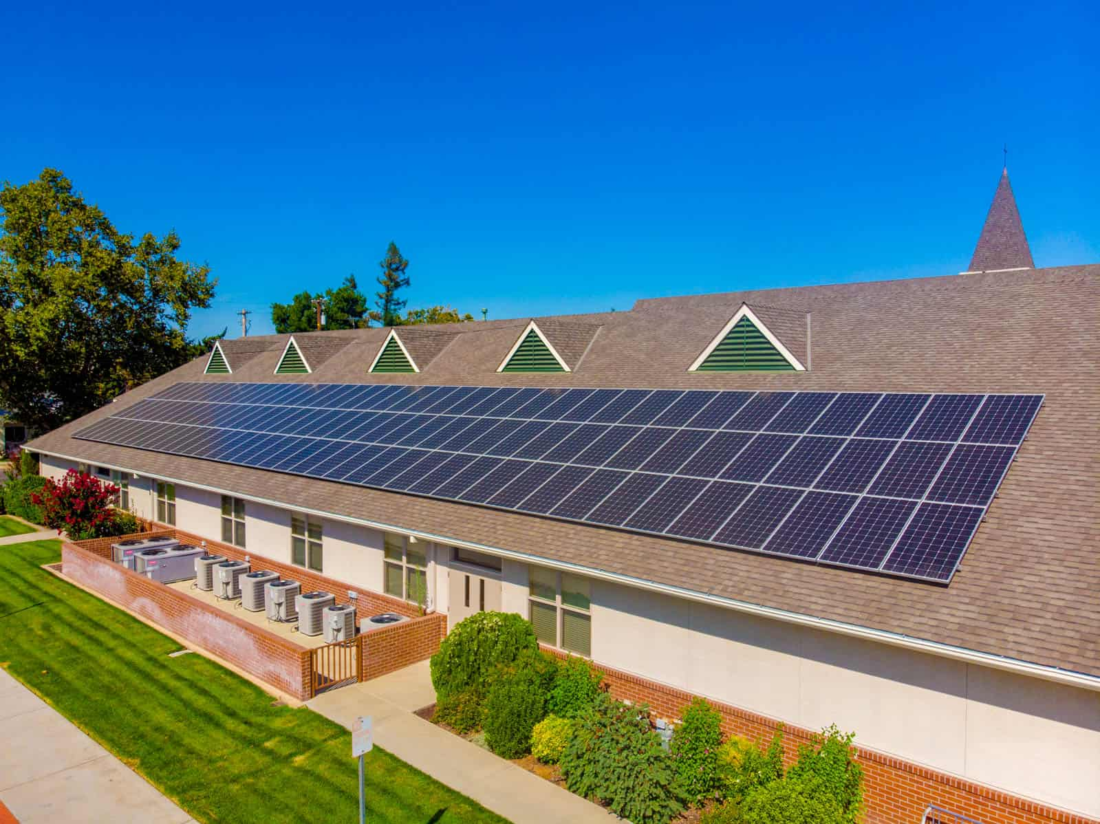 low altitutde drone photo of solar panel installation on church rooftop in Ripon, California