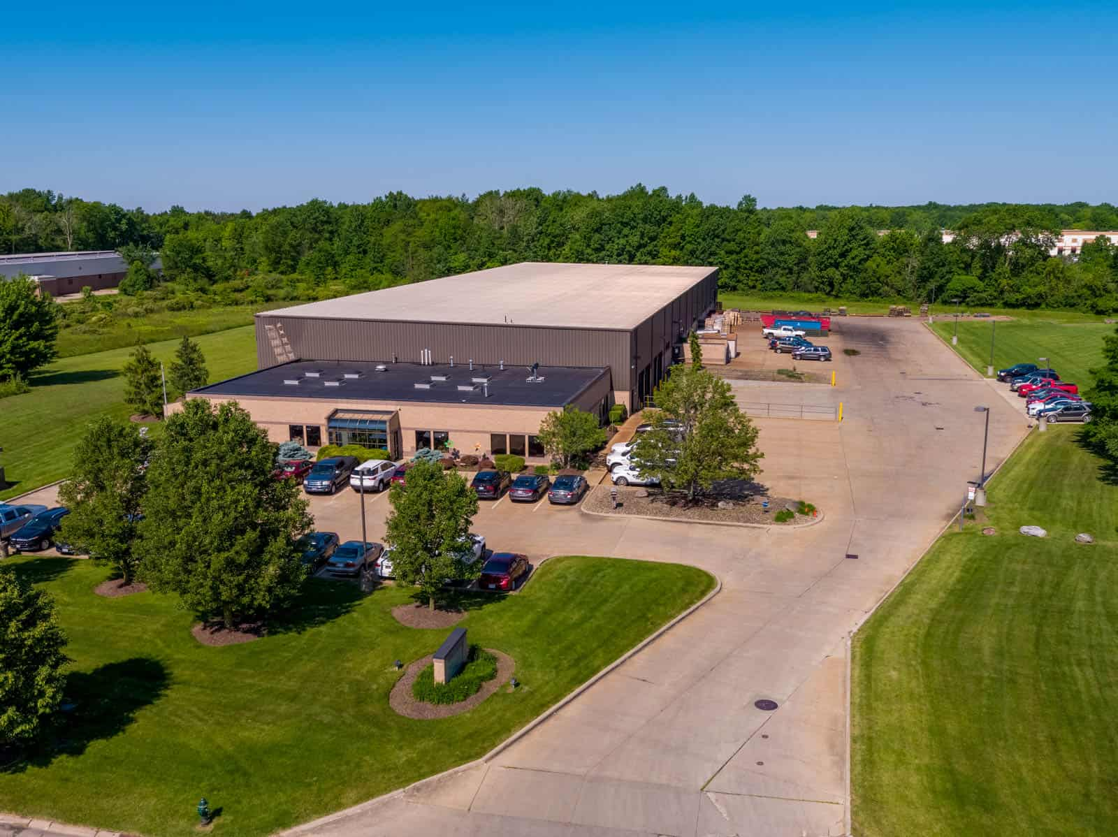 low altitude drone photo of commercial property in Strongville, Ohio