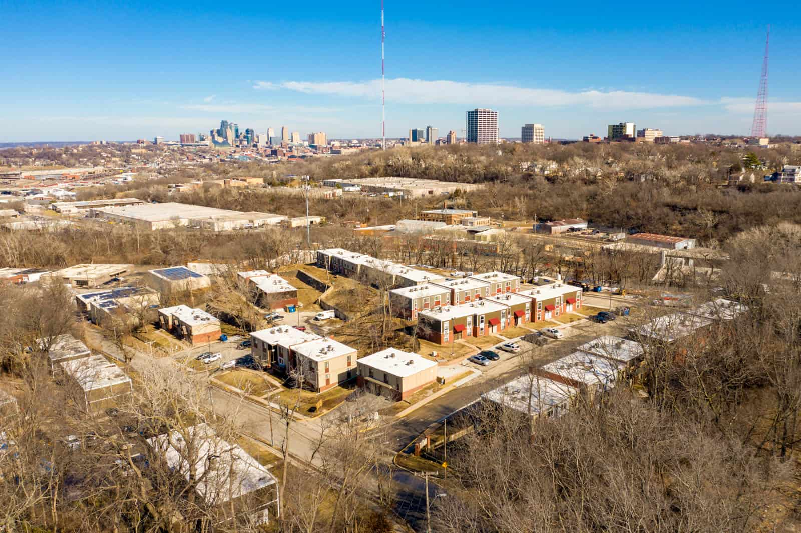 aerial drone photo of apartment complex with Kansas City in background in Kansas City, Missouri