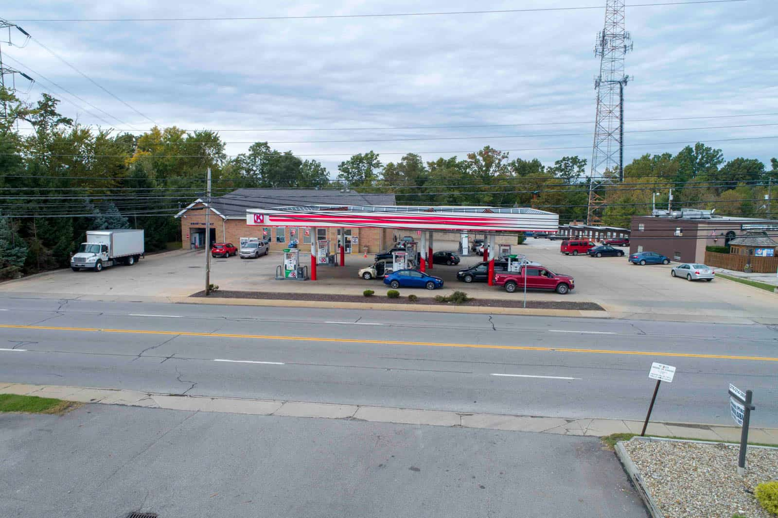 aerial drone photo of gas station taken from across the street in Northfield, Ohio