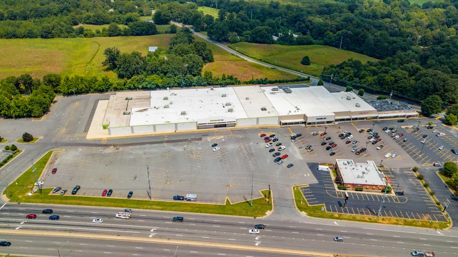 aerial drone photo of commercial shopping center in Monroe, North Carolina