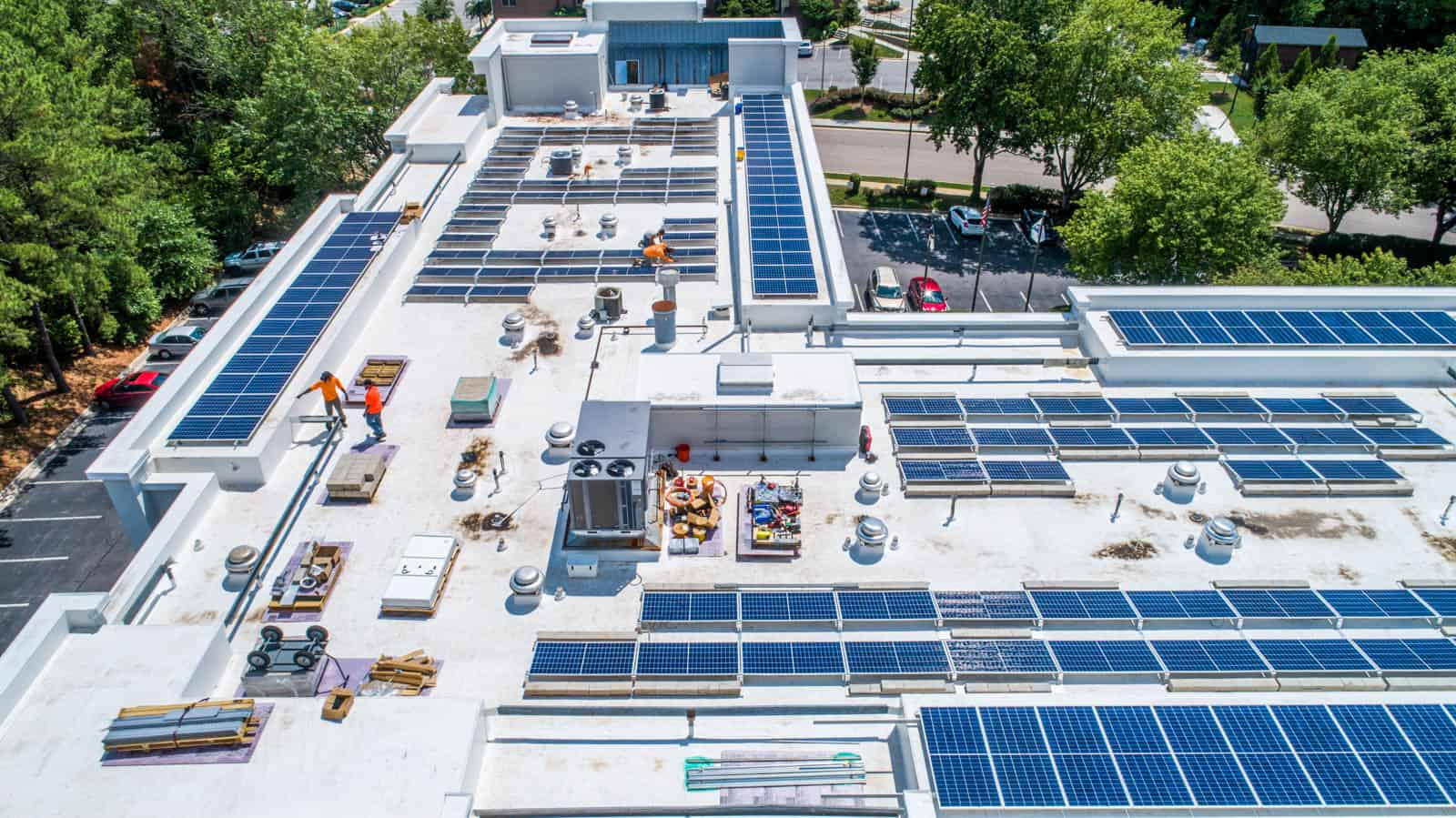 aerial drone photo of solar panel installation on Comfort Inn rooftop in Raleigh, North Carolina