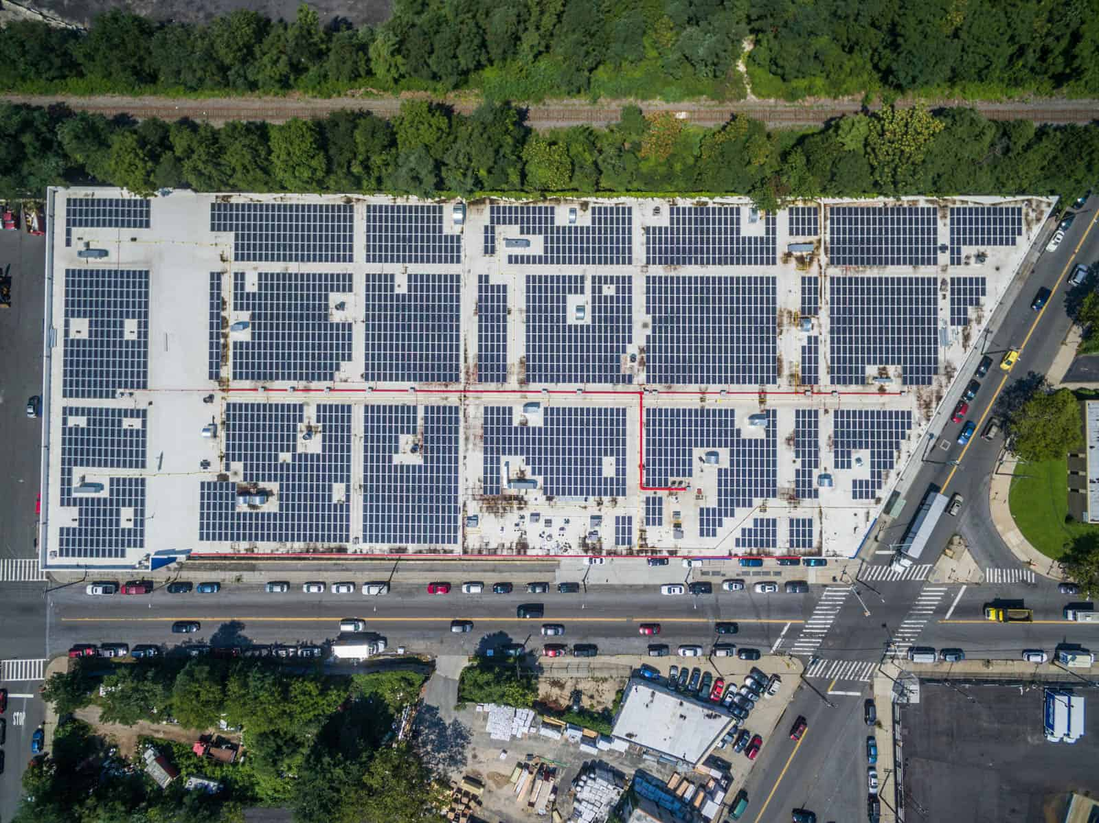 top down drone photo of solar panel inspection on commercial building rooftop