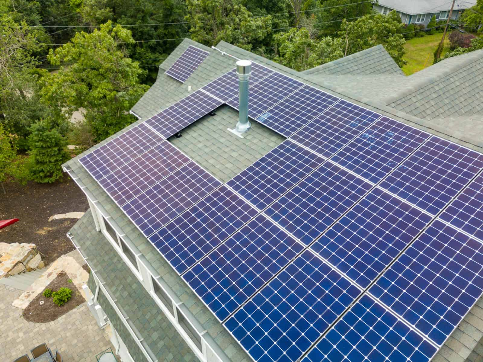 close up drone photo of solar panel installation on residential property in Cohasset, MA