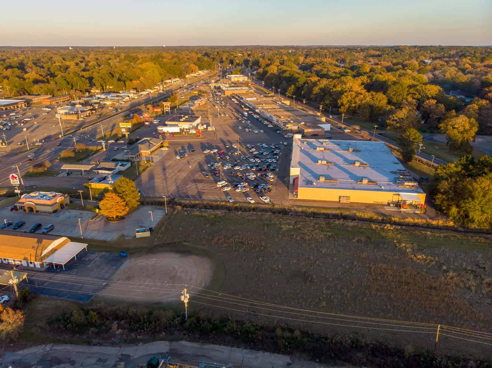 high altitude aerial overview photo of commercial shopping center in Pearl, MS