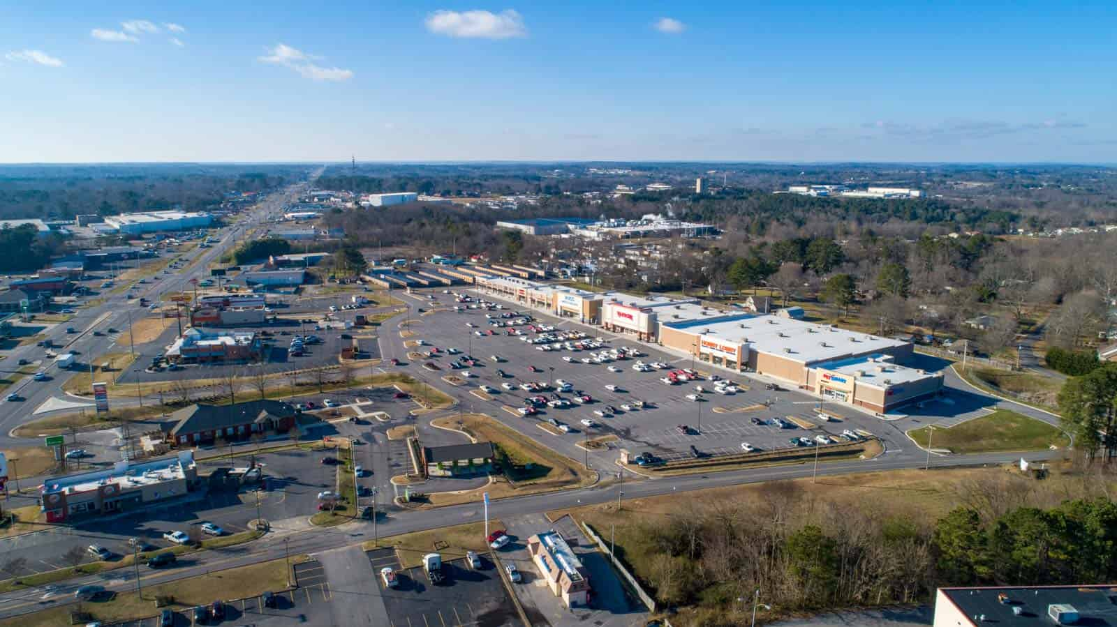 aerial drone photo of commercial strip mall in Albertville, AL