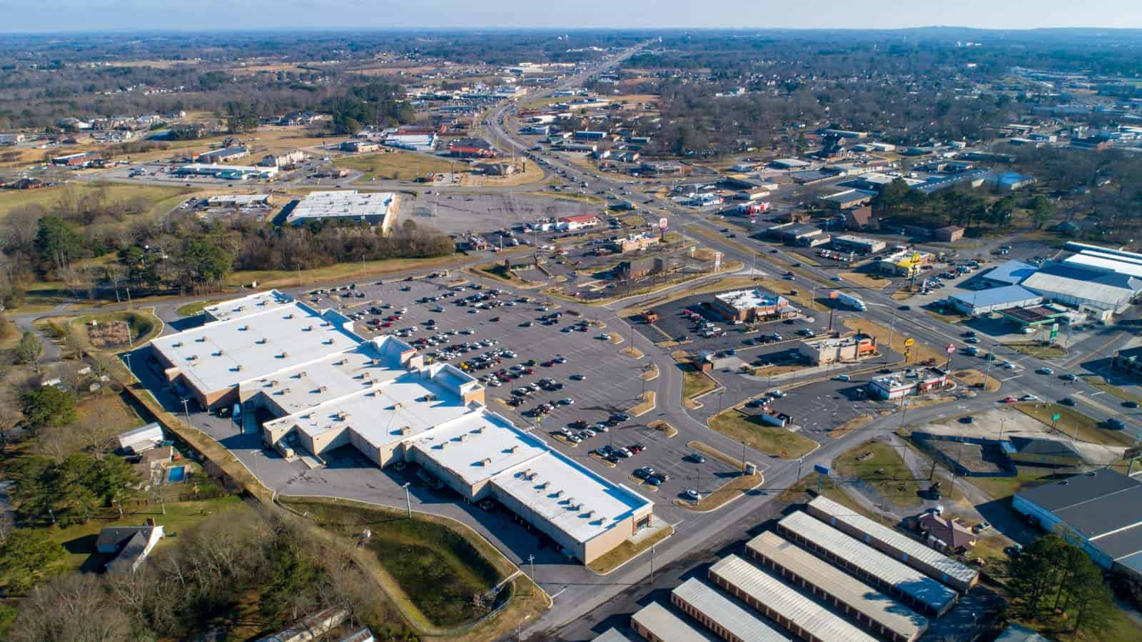 high altitude drone photo of commercial strip mall in Albertville, AL
