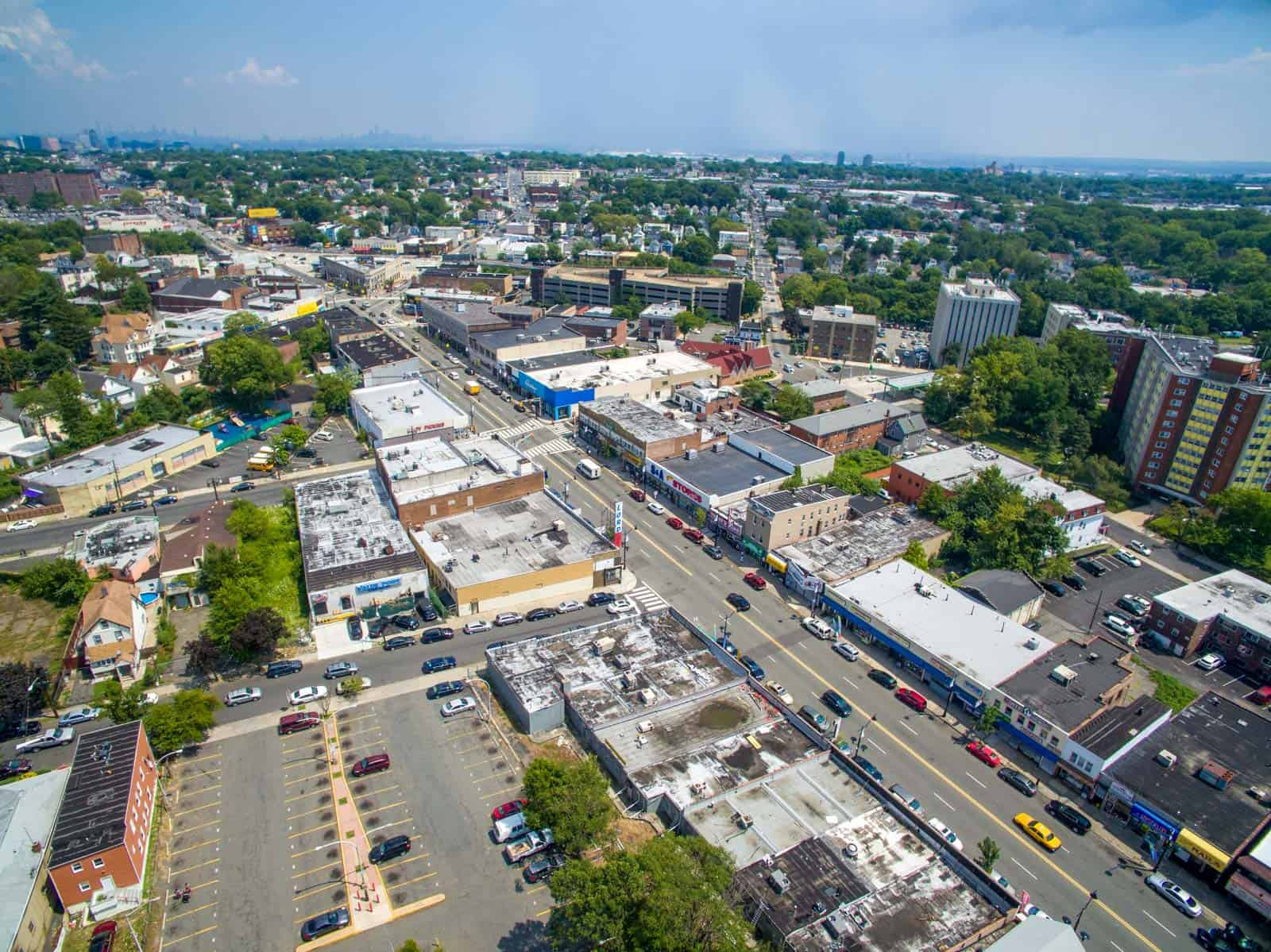 high altitude aerial drone photo of overview of commercial real estate property and surrounding area