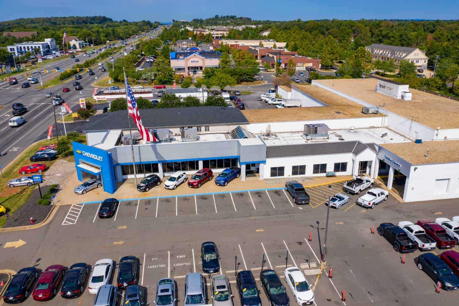 drone photo of Chevrolet dealership entrance with large American flag in Sterling, VA