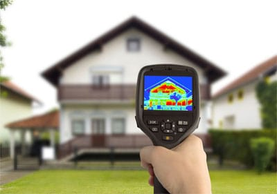 infrared camera pointed at residential home