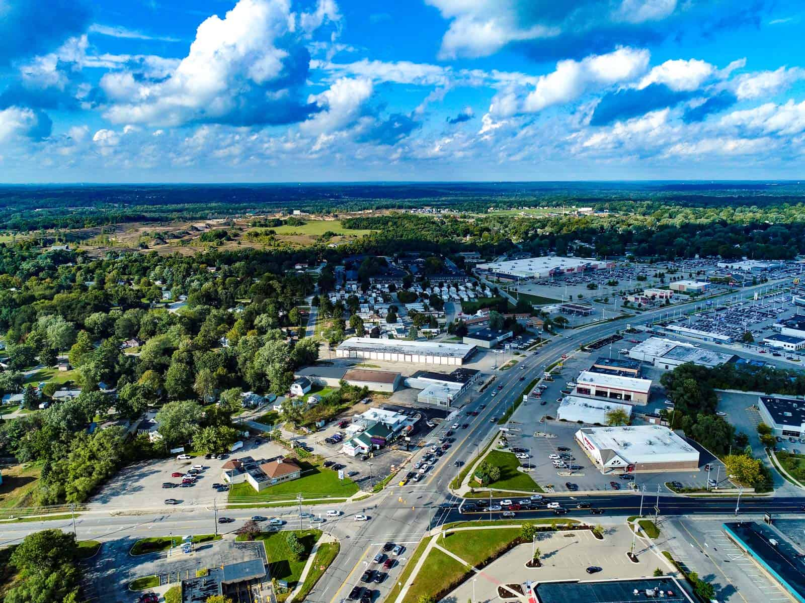 aerial drone photo of commercial real estate shopping plaza next to intersection in Grand Rapids, MI