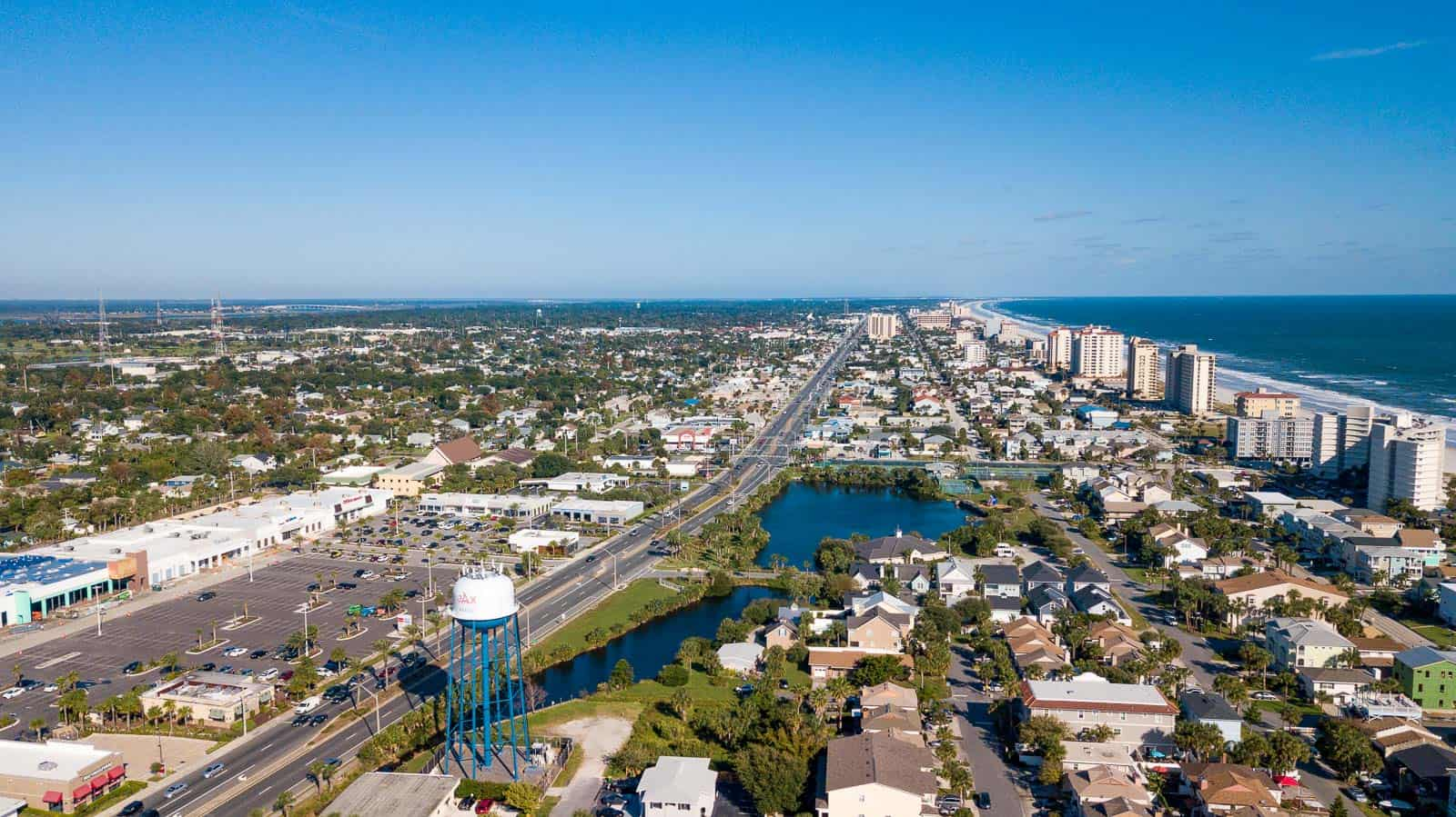 high altitude drone photo of commercial real estate property next to beach in Jacksonville Beach, FL
