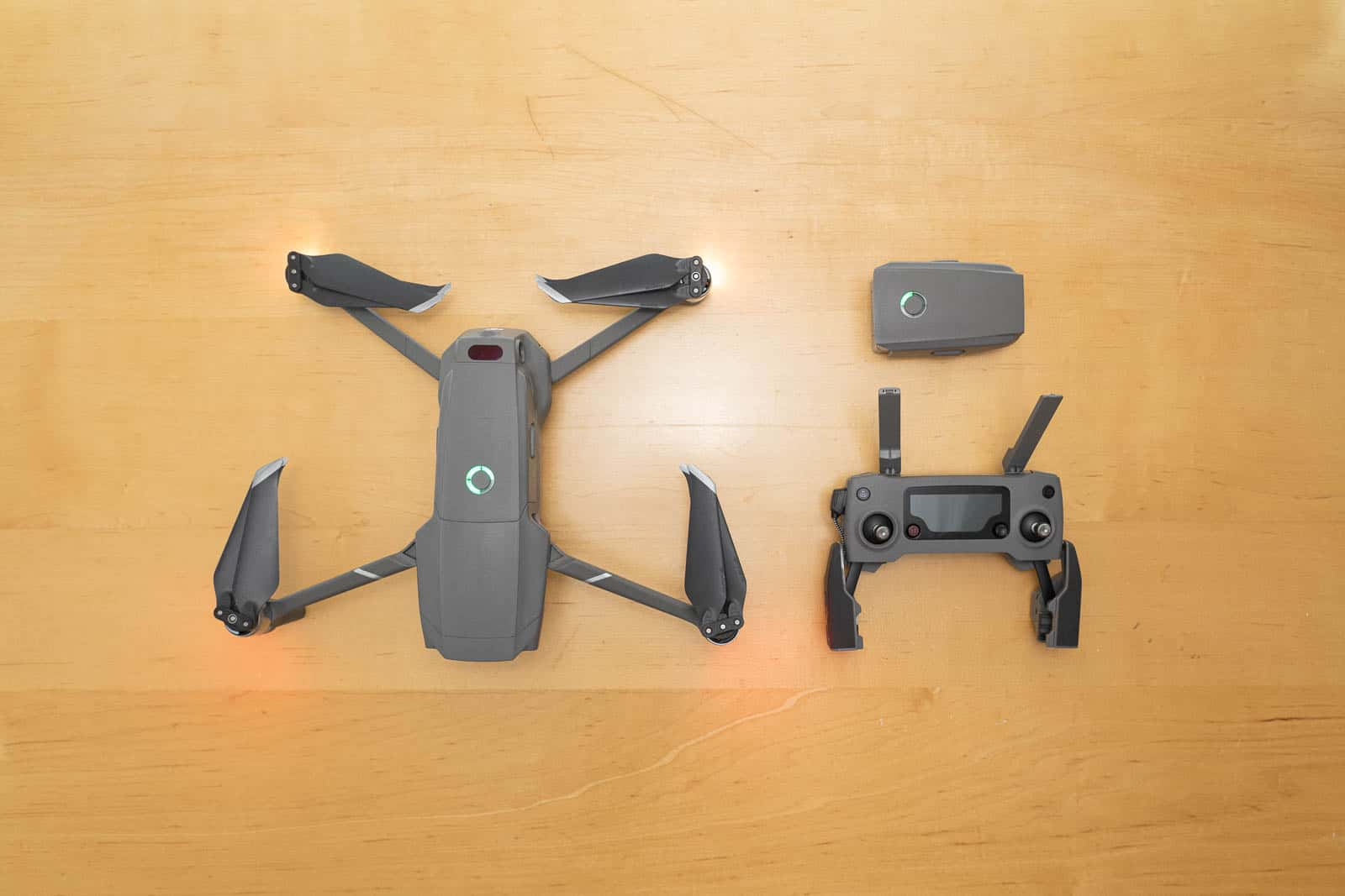 mavic 2 pro drone next to battery and remote controller